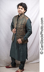 young indian model in green kurta side pose