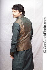 young male model in green kurta posing back