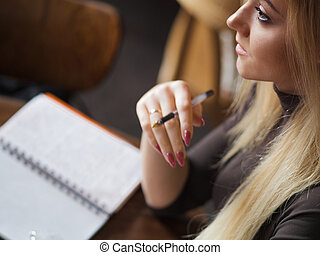 Young woman student of the University. Preparing exam and...