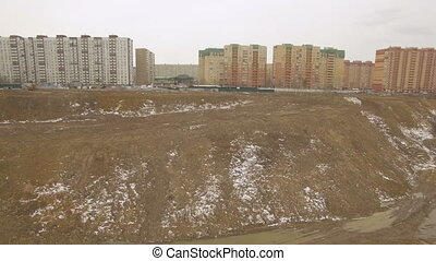Construction site near the lake - Aerial view of a ground...