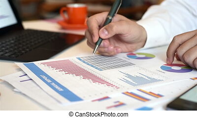 Trader Man Working With Documents And Financial Report....