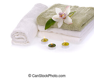spa still life - stack of towels with white orchid flower...