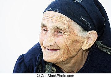 Portrait of smiling elderly woman - Closeup portrait of...