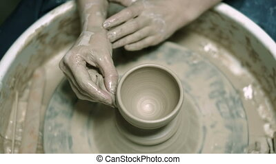 Clay potter creating on the pottery wheel 4k