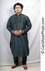 indian male model in green kurta holding hands front pose