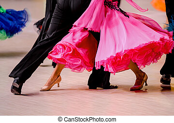 competitions in ballroom dancing. black tailcoat and pink...