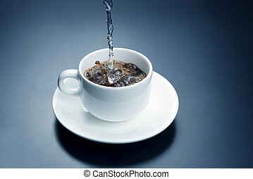 boiled water from the kettle is poured into a white Cup for...