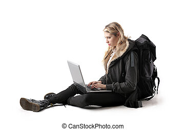 Traveller woman - Woman with bags looking at laptop