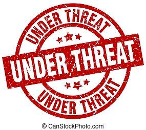 under threat round red grunge stamp