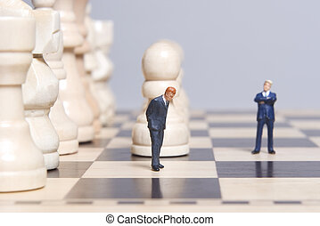 Figurine and chess pieces - Business figure Placed on a...