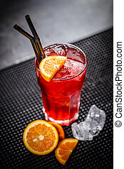 Red cocktail with orange slice