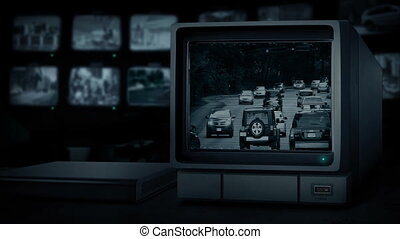 CCTV Monitoring Traffic In Rush Hour - TV monitor showing...