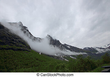 The Troll Wall in Norway, magestic summer foggy mountains
