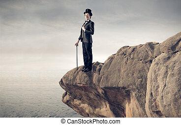 Man on mountain - Elegant man on mountain