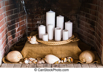 decorative fireplace with candles