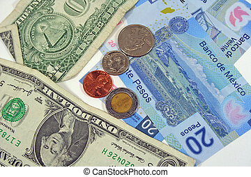 American and Mexican money on white background isolated