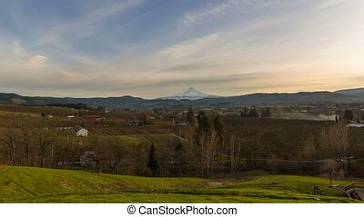 Time lapse of clouds over Mt. Hood and pear orchards in Hood...