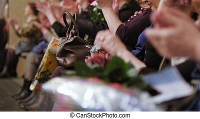 Spectators in the Theater hall applauding the performance on...