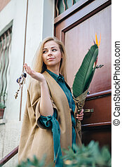 Real estate young woman city building door customer...