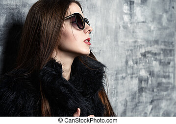 brunette woman - Attractive young woman wearing black...
