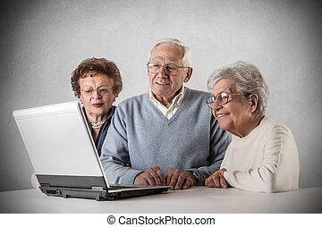 Old people and laptop - Old people looking at laptop