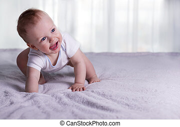 First steps of funny baby boy. Cute infant kid begining to...