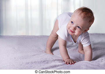 Cute baby boy doing first steps. Lovely infant kid begining...