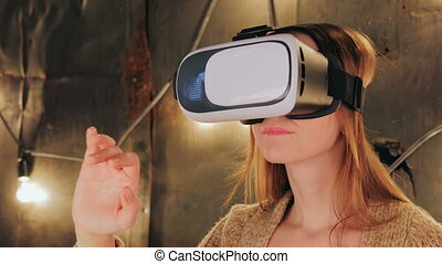 Young woman using Virtual Reality Glasses. Virtual reality...