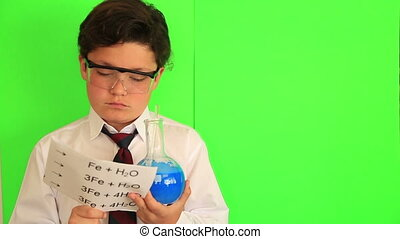 Boy is making science experiments - Portraitof a school boy...