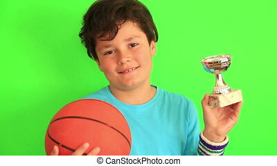 Boy holding basketball ball and champion trophy - Portrait...