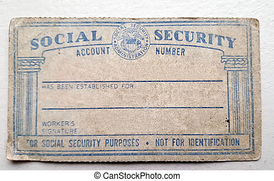 worn American social security card - close up of faded...