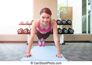 sport woman push-up - beauty sport woman smile and push-up...