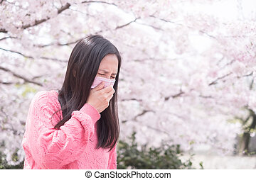 woman with hay fever - woman feel pain and wear mask with...