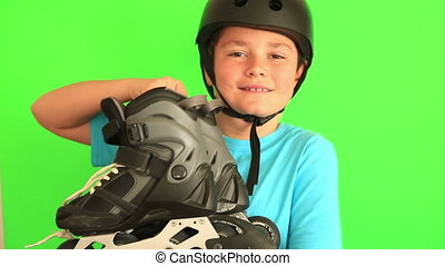 Child with roller skates - Young, happy roller boy in...