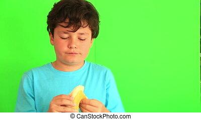 Child eating banana on chroma key background