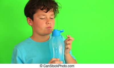 Child drinking water on chroma key background - Portrait of...
