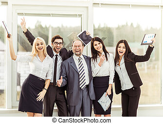 boss and happy business team rejoice after signing a...