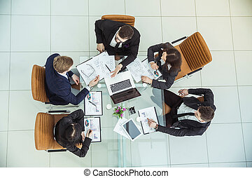 business team discussing the company's financial plan for a modern workplace