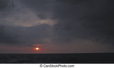 storm at sunrise - time lapse of storm clouds at sea sunrise