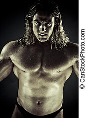 Muscular man - Dramatic image of a beautifully sculpted...