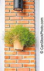 vintage filter : flower pot hanging orange brick post .