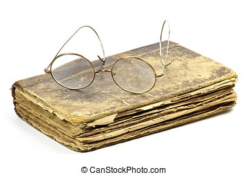 antique book with glasses isolated on white background