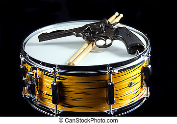 Tiger Drum and Revolver Gun Isolated On Black - A tiger...