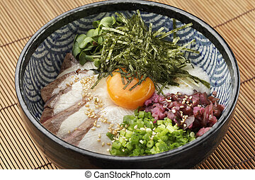 Bowl of ramen udon noodle with eeg, onion, pork and sprouts