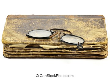 antique book with pince-nez isolated on white background