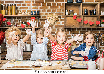 Children cooking biscuits
