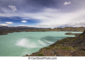 shore of blue lake and clouded sky in patagonia at daylight...