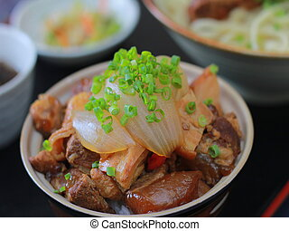 Sauteed pork with onion in chinese bowl