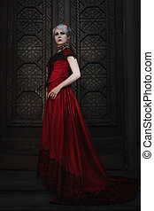 Woman in a red ball gown. - Woman in a red ball gown, she...
