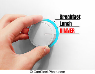 Male hand turns the switch. Switches mealtimes. Chose the Dinner